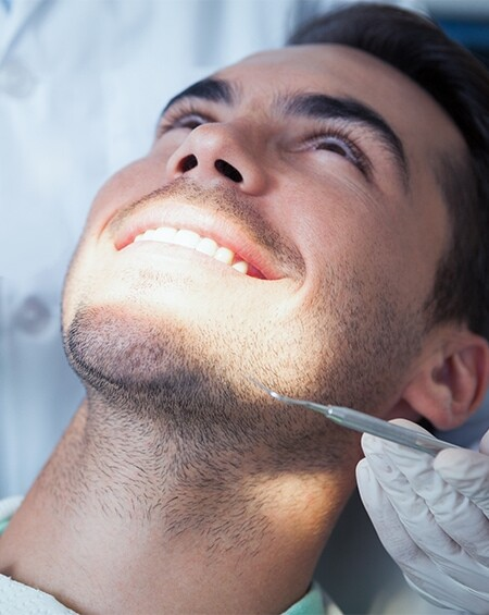 patient's teeth whitening treatment in calgary